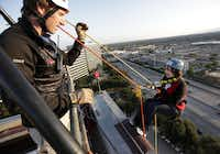 Trevor Deighton of Over the Edge guided Anna deHaro of Clear Channel Radio DFW off the edge of the the InterContinental Dallas Hotel in Addison as part of a fundraiser for Special Olympics Texas on Friday.