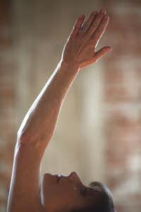 Annette Lentz teaches yoga to a class in the Billups Agency in Downtown Dallas on January 31, 2013.