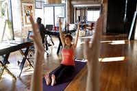 Annette Lentz teaches yoga to a class in the Billups Agency in Downtown Dallas.