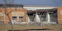 Storm damages of Donald T. Shields Elementary School are seen from Lake Ridge Drive in Red Oak.( Jae S. Lee  -  Staff Photographer )