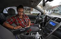 """""""My passion is for the safety  and well-being of children,"""" says Pruitt, checking an email in her car after a visiting a local family.(Jae S. Lee - Staff Photographer)"""