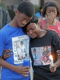 Nycholas George and Angela Ravenell mourned slaying victim Lahomer Anderson during a candlelight vigil on Tuesday.Michael Ainsworth  -  Staff Photographer
