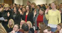 The new assistant district attorneys were sworn in at the Frank Crowley Courts Building in Dallas on Thursday along with their new boss.(Michael Ainsworth - Staff Photographer)