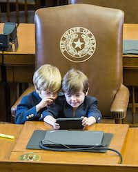 Rep. Dade Phelan's sons  — Ford, 6, and Mack, 5 — played at their dad's desk on Monday, the last day of the session.(Ashley Landis - Staff Photographer)