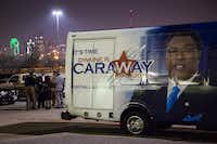 Dwaine Caraway huddled with supporters and staffers in the parking lot behind a campaign vehicle after participating in a candidate forum at the African American Museum in Fair Park in February.( Smiley N. Pool  -  Staff Photographer )