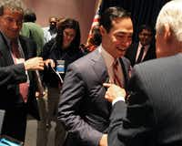 San Antonio Mayor Julian Castro (center) talked with Fred Head, a former legislator from Athens, after a credentials committee meeting at the Charlotte Convention Center on Sunday.