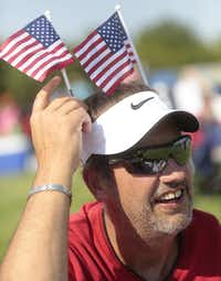 Michael Neumann of  Garland, adjusts some decorative U.S. flags during the Kaboom Town -4th of July celebration -on July 3, 2013 at Addison Circle Park in Addison.   (Michael Ainsworth/The Dallas Morning News)(Michael Ainsworth - Staff Photographer)