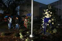 An evening prayer group walked past two wreaths placed in front of the Kaufman County Courthouse in memory of District Attorney Mike McLelland and his wife, Cynthia McLelland, on Wednesday.