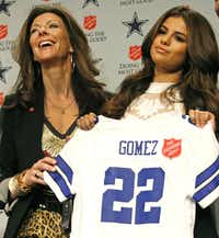 Charlotte Jones Anderson, executive vice president and chief brand officer for the Dallas Cowboys, poses with singer and actress Selena Gomez, who will perform during halftime of this year's Thanksgiving Day game.