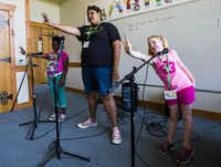 Adamiria Green (center), 14 , says Camp I-Thonka-Chi helped her come to terms with her sister's death and her own trauma after being badly burned in a house fire. She and Brianna James (left), 12, and Avery Mathis, 8, rehearsed for a glee club performance recently at the camp, held at Camp John Marc near Meridian.(Ashley Landis - Staff Photographer)