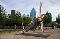 Marie Gwyn does yoga at Klyde Warren Park.(Ashley Landis - Staff Photographer)