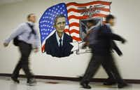 Students walk past a mural of President Obama painted by art teacher Dane Larsen and the art club at the Barack Obama Male Leadership Academy in Dallas. (2011 File Photo/Staff)