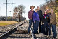 Rockwall County Open Space Alliance members (from left) Bob DeJean, Nell Welborn, Dale Morgan and Becky Burkett, Verdunity principal Kevin Shepherd and Fate Mayor Lorne Megyesi visit a proposed rail corridor trail.(Smiley N. Pool - Staff Photographer)