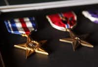 A Silver Star (left) and a Bronze Star with Valor. (2015 File Photo/Tom Fox)