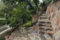 The City of Dallas Park and Recreation Department spent $2.1 million to restore stonework built in the 1930s at Reverchon Park by Works Progress Admnistration crews. In addition to stairs and terraces built into the park's hillside, the project included a floral amphitheater known as the Iris Bowl, a fountain entry and a picturesque bridge over Turtle Creek.Michael Ainsworth - Staff Photographer