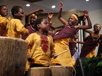 Peninah Aliano (second from right), 10,  and other members of the African Children's Choir perform at Lake Highlands Presbyterian Church.