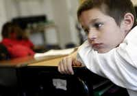 First-grader Christian Garcia is lost in thought during class at City Park Elementary in Dallas. The school serves Christian and other children who are homeless.