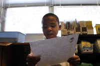 Jaylin Rogers shares a letter he wrote to his mother with fellow classmates at City Park Elementary, which serves homeless shelters within its boundaries.