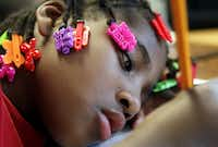 Myvonjayla Davis writes a letter to her father, part of an assignment in her first-grade class at City Park Elementary.