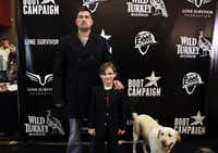 """Retired Navy SEAL Marcus Luttrell, author of """"Lone Survivor"""" (with Rhett Reuland and Luttrell's service dog, Mr. Rigby) attended a Plano screening of the film based on his book on Tuesday."""