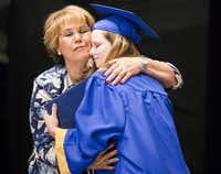 Principal Sylvia Palacios hugged Kenzie Leigh Appell-Lones after presenting her with her diploma during the Frisco High School graduation ceremony.( Smiley N. Pool  - Staff Photographer)