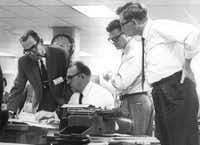 Felix McKnight (seated) joined co-publisher James Chambers Jr. (left), Blackie Sherrod and A.C. Greene as the staff of the Dallas Times Herald worked on coverage of the JFK assassination on Nov. 22, 1963.( File Photo  - digital file)