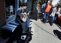 Russ Higginbotham played his guitar on a bench for passers-by in Bishop Arts Friday afternoon, March 07, 2014. There are walkable neighborhoods in Dallas like the Bishop Arts District, Deep Ellum, and the West Village, but downtown Dallas is still lacking that extra something that attracts more pedestrians, shoppers, and diners.( Mona Reeder  -  Staff Photographer )