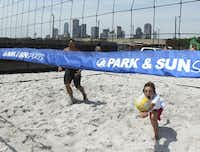 Kade Bontrager,13, makes a diving save whle playing volleyball at the soon to open Sandbar Cantina and Grill in Deep Ellum.