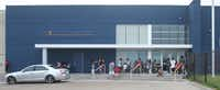 Parents and students waited to get their first look at KIPP Destiny Elementary on Thursday. The college-preparatory charter school is housed in a renovated Mervyn's store.
