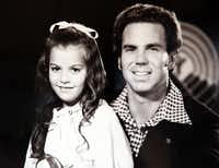 Seven-year-old Gayla Vaughan, recovering from open-heart surgery, had her story told in a United Way commercial with Dallas Cowboys quarterback Roger Staubach in 1974.