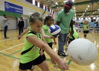 Zoe Smith of the Lil' Smash team worked on her serve before Saturday's volleyball tournament at PSA 1.