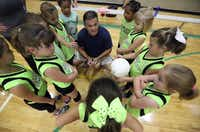 Coach Mitch Metersky gave Lil' Smash players a pep talk before the volleyball team's game Saturday at PSA 1. Five thousand volunteers handle coaching, running the leagues and other tasks for PSA, which has a full-time staff of 22.