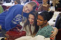 From left:  Erika Minich, Lauren McCoy and Selam Rinkevich took time out for a photo during Monday's send-off party for Texas Scottish Rite Hospital amputee patients who are going on a ski trip to Winter Park, Colo.( Kye R. Lee  -  Staff Photographer )