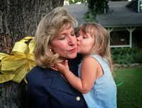 "Jan Bynum  got a kiss from Alexis, then 2, at their Farmers Branch home in July 1998. For years, Kelli's daughter was told only that ""Mommy is lost and we have a lot of people looking for her.""(Kim Ritzenthaler - 118169)"