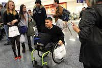 At DFW International Airport, Brian Monroy-Orozco and other amputee patients from Texas Scottish Rite Hospital for Children board an American Airlines flight to Denver heading for the slopes of Winter Park, Colo., for the hospital's 33rd annual amputee ski trip.