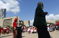 """A rally protesting the abduction of more than 200 girls in Nigeria was held Sunday afternoon, Mother's Day at Dallas City Hall.  Dozens of people filled the plaza to listen to speakers, pray, and chant, """"Bring back our girls.""""Mona Reeder - Staff Photographer"""