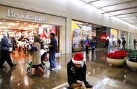 Tyler Webb showed a bit of holiday spirit while waiting for friends at NorthPark Center on Tuesday.