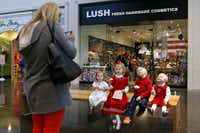 From right: John Stock, 2, Sutton Stock, 5, Eleanor Murchinson, 5, and Saylor Stock, 2, huddled for a photo after visiting Santa at NorthPark Center on Tuesday.