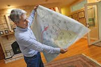 Channel 5 senior meterologist  David Finfrock displays a hand-drawn weather map he saved from the early days of his broadcast career.( Louis DeLuca  - Staff Photographer)