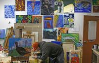 Carlos Saenz works on an art project during the Open Art Program at The Stewpot homeless resource center.( Staff photo by NATHAN HUNSINGER  -  DMN )