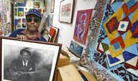 Stephen McGee shows his drawing of Robert Johnson at The Stewpot that he drew for one of the past Open Art Programs.( Staff photo by NATHAN HUNSINGER  -  DMN )