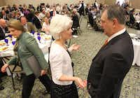 Dallas Mayor Mike Rawlings (right) visits with Genesis Women's Shelter executive director Jan Langbein before addressing his domestic violence program at a breakfast assembled by Genesis Women's Shelter.( Staff photo by Louis DeLuca  - Staff Photographer)