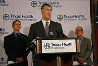 Dallas Mayor Mike Rawlings offers an assuring word as news reports of another Ebola victim surfaces, during a press conference at Texas Health Presbyterian Hospital Dallas on Sunday, October 12, 2014.  (Louis DeLuca/The Dallas Morning News)(Louis DeLuca - Staff Photographer)