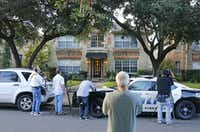 Media and bystanders look at the residence at 5700 block of  Marquita, where reportedly a person diagnosed with Ebola lived, photographed in Dallas on Sunday, October 12, 2014.  (Louis DeLuca/The Dallas Morning News)(Louis DeLuca - Staff Photographer)