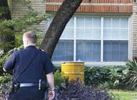 A barrel for disposal of hazardous waste sits outside the residence at 5700 block of  Marquita, where reportedly a person diagnosed with Ebola lived, photographed in Dallas on Sunday, October 12, 2014.  (Louis DeLuca/The Dallas Morning News)Louis DeLuca - Staff Photographer