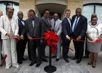 Dallas City Council members and other dignitaries gathered at the new Lancaster Urban Village apartment and retail complex to celebrate a ribbon-cutting ceremony and the building's opening Thursday morning.( Mona Reeder  -  Staff Photographer )