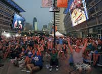 Fans watching on screens in the plaza outside American Airlines Center celebrated a Mavericks basket in the third quarter.