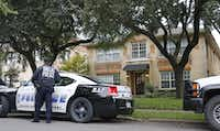 Police guard the residence at 5700 block of  Marquita, where reportedly a person diagnosed with Ebola lived, photographed in Dallas on Sunday, October 12, 2014.  (Louis DeLuca/The Dallas Morning News)(Louis DeLuca - Staff Photographer)