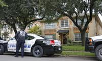 Police guard the residence at 5700 block of  Marquita, where reportedly a person diagnosed with Ebola lived, photographed in Dallas on Sunday, October 12, 2014.  (Louis DeLuca/The Dallas Morning News)Louis DeLuca - Staff Photographer
