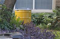 A barrel for disposal of hazardous waste stand by at the residence at 5700 block of  Marquita, where reportedly a person diagnosed with Ebola lived, photographed in Dallas on Sunday, October 12, 2014.  (Louis DeLuca/The Dallas Morning News)(Louis DeLuca - Staff Photographer)